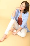Relaxed Healthy Happy Young Woman Sitting on Floor Contented. A DSLR royalty free image, of attractive happy young contented relaxed young woman sat on floor Stock Images