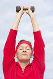 Relaxed healthy mature woman exercising Stock Images