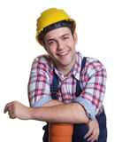 Relaxed hispanic construction worker with water pipe Stock Photos