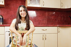 Relaxed housewife in kitchen Stock Photo