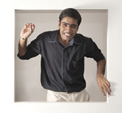 Relaxed indian man with reasons to be cheerful 2 Stock Images