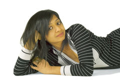 Relaxed Indian woman lying on the floor Stock Photos