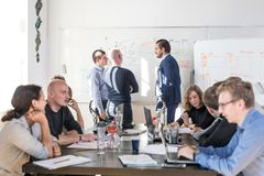 Relaxed informal IT business startup company team meeting. Royalty Free Stock Photo