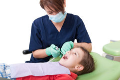 Relaxed kid on dentist chair Royalty Free Stock Image