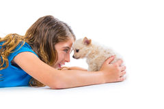 Relaxed kid girl and puppy chihuahua dog lying Royalty Free Stock Photo