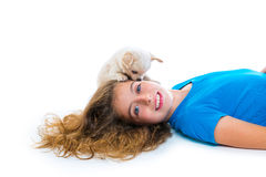 Relaxed kid girl and puppy chihuahua dog lying Royalty Free Stock Images