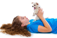 Relaxed kid girl and puppy yawning chihuahua dog Royalty Free Stock Images