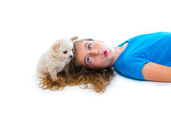 Relaxed kid girl whistling puppy chihuahua dog Stock Image