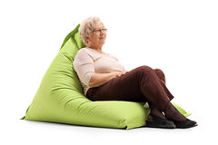 Relaxed lady sitting on a beanbag Royalty Free Stock Image