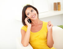 Relaxed lady talking on her mobile phone Royalty Free Stock Photos