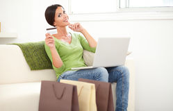 Relaxed lady using a laptop for electronic payment Royalty Free Stock Image