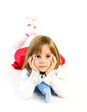 Relaxed little girl is lying Stock Photo