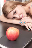 Relaxed looking an apple and book Royalty Free Stock Photo