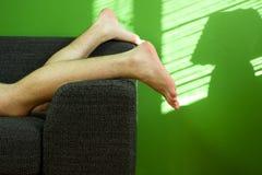 Relaxed man. On black sofa Stock Photo