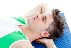Relaxed man doing fitness Royalty Free Stock Photo