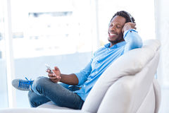 Relaxed man enjoying music Stock Images