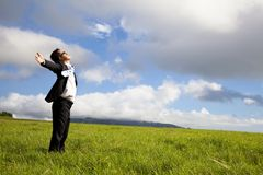 Relaxed man in green field Royalty Free Stock Photography