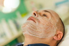 Relaxed man having a face massage and a peeling treatment Royalty Free Stock Photography