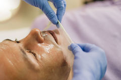 Relaxed man having a face massage and a peeling treatment Royalty Free Stock Images