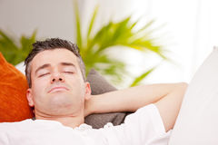 Relaxed man having finally his time off Stock Image