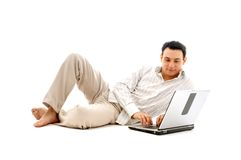 Relaxed man with laptop. Computer over white Stock Photo