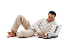 Relaxed man with laptop #2. Relaxed man with laptop computer over white Stock Image