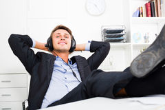 Relaxed man listening music Stock Photos