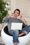 Relaxed man listening to music. On laptop Stock Photos