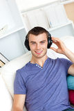 Relaxed man listening to music with headphones Stock Image