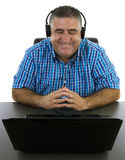 Relaxed man listening to music. On his headphones Royalty Free Stock Photography