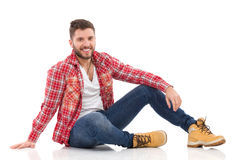 Relaxed man in lumberjack shirt Stock Photography