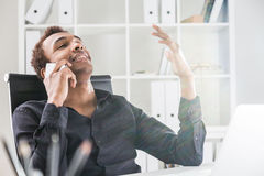 Relaxed man on phone Stock Images