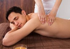 Relaxed Man Receiving Shoulder Massage In Spa Stock Image