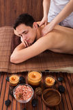 Relaxed Man Receiving Shoulder Massage In Spa Royalty Free Stock Photos