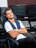 Relaxed Man Sitting Arms Crossed At Mixing Table Royalty Free Stock Images