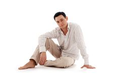 Relaxed man sitting on the flo
