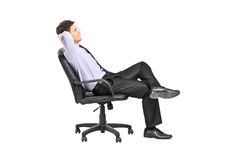 Relaxed man sitting in an office chair royalty free stock photo