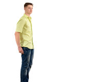 Relaxed man standing with the hands in the pocket from profile looking far away. Royalty Free Stock Images