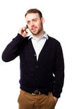 Relaxed man talking on a mobile phone Stock Photo