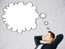 Relaxed man with thought bubble Stock Photo