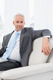 Relaxed mature businessman with laptop at home Royalty Free Stock Image