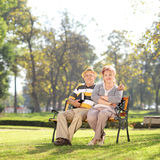 Relaxed mature couple enjoying a sunny day in park. Shot with atilt and a shift lens Stock Photos