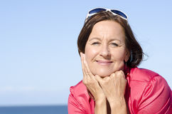 Relaxed mature woman happy outdoor isolated Stock Photo