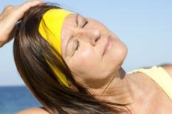 Relaxed mature woman ocean  Stock Photos