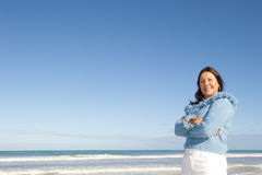 Relaxed mature woman ocean background Stock Images
