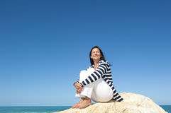 Relaxed mature woman ocean background Royalty Free Stock Photography