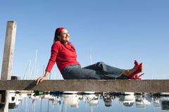 Relaxed mature woman outdoor marina Royalty Free Stock Images