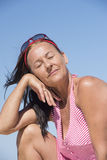 Relaxed mature woman sunny day posing Stock Photo