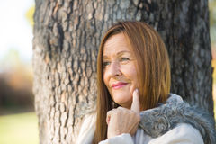 Relaxed Mature woman winter jackte outdoor Royalty Free Stock Photography
