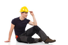 Relaxed mechanic sitting on a floor Stock Photography